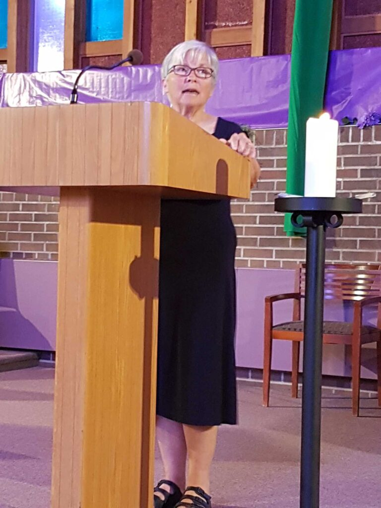 Woman standing at a lectern