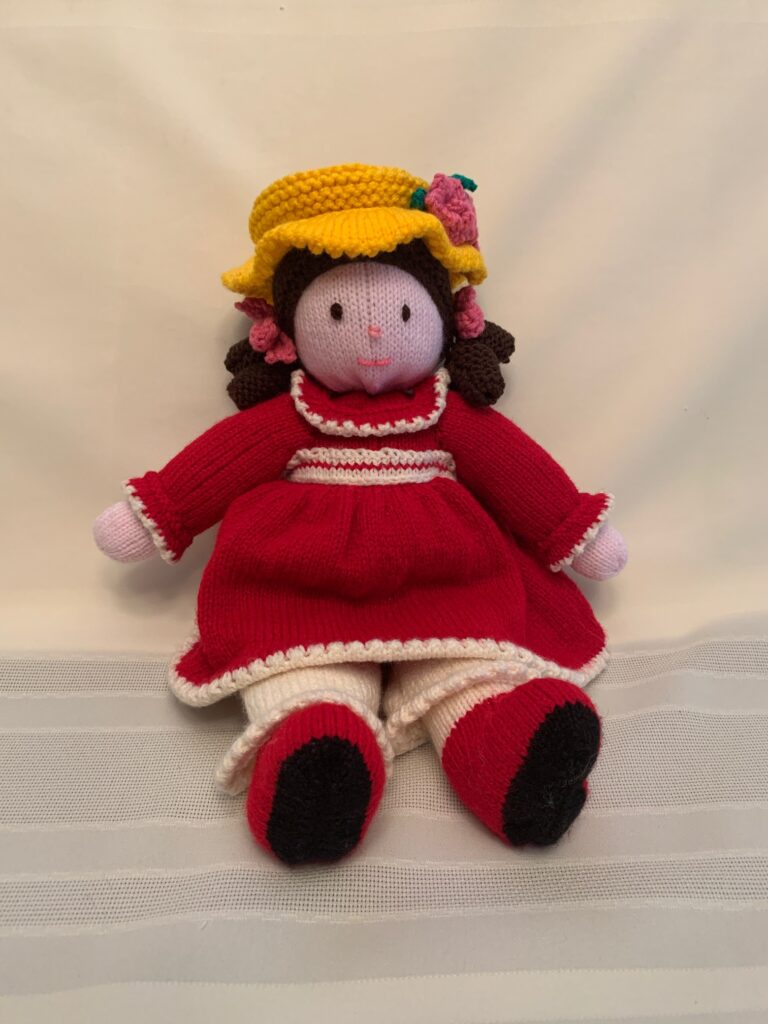 Crocheted doll in red dress