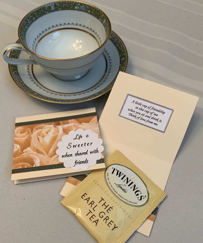 Tea cup and saucer, greeting card, tea bag