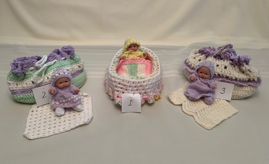 Crocheted bags with dolls in front