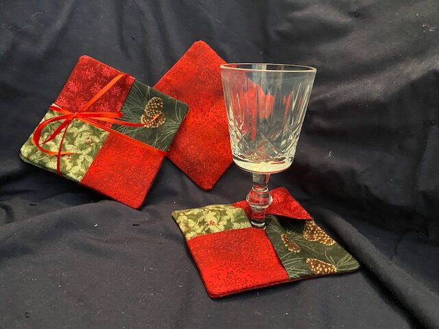 Holiday fabric coasters with wine glass