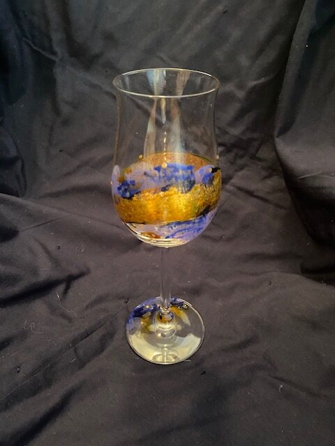 wine glass with blue and gold accents