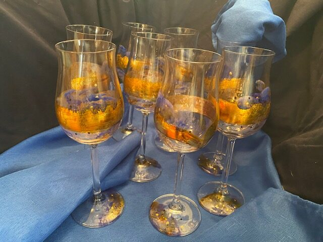 wine glasses with blue and gold accents