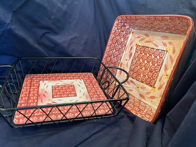 casserole dish with red pattern design and matching serving rack