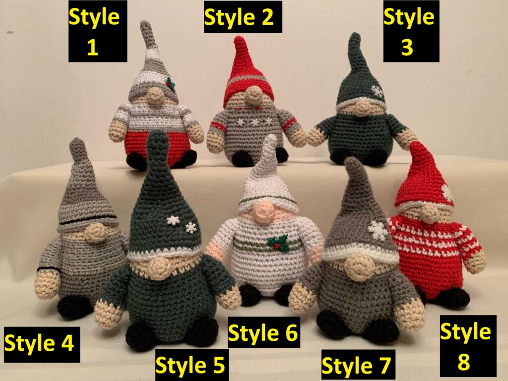 8 different multi-coloured crocheted gnome figures