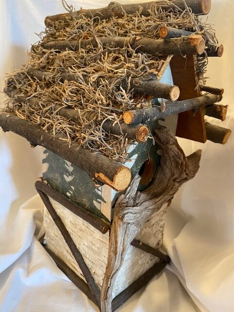 wooden bird house with peaked roof