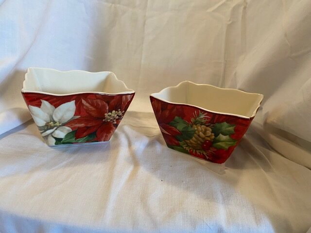 two small china serving dishes with Christmas theme pattern