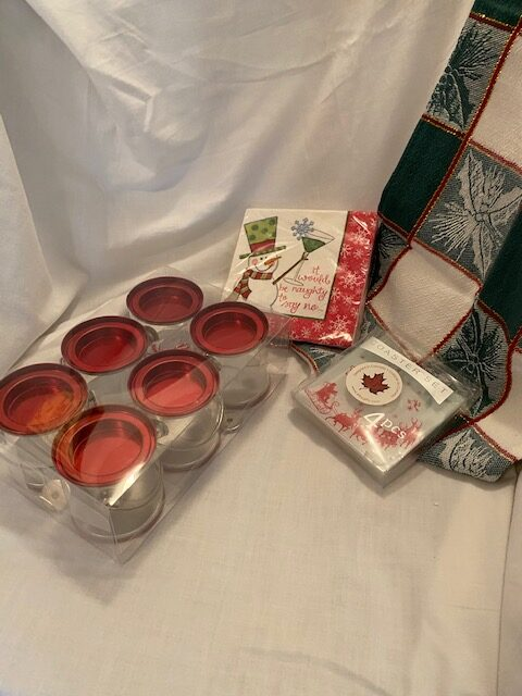 set of party favours in small paint cans, paper napkins, set of coasters, tea towel