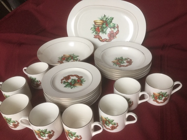 Sonata porcelain dessert set, with dessert plates, dessert bowls, mugs, serving bowl and serving platter, all with Christmas wreath pattern of holly, ribbon and candle