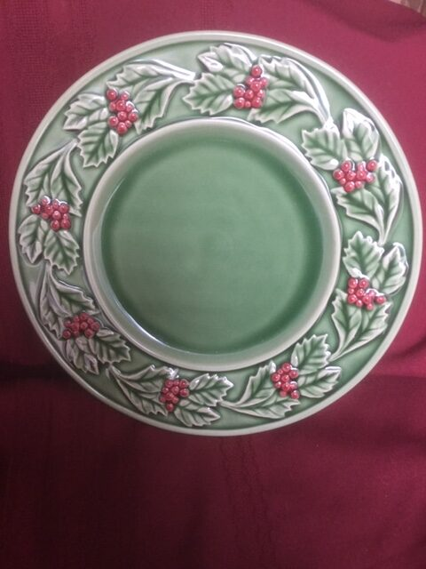 dinner plate, green base, with patter of holly leaves and berries around the green rim