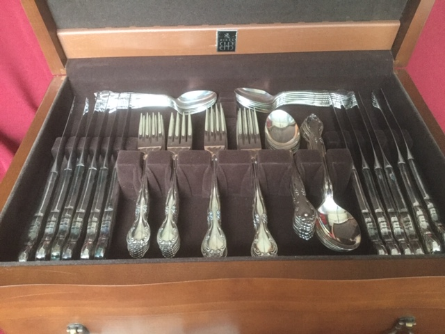 silver-plate flatware service shown in wooden storage box with black fabric lining - Birks Community