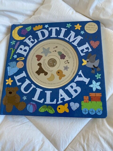 Bedtime Lullaby book, blue cover with colourful graphics