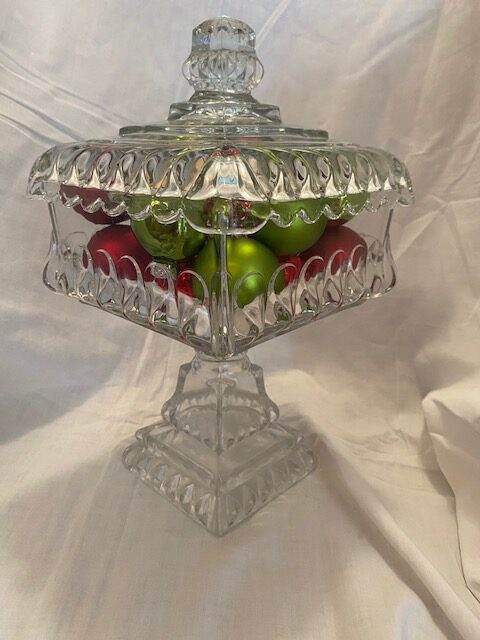 Square crystal serving dish with lid and integral pedestal, filled with red and green Christmas balls