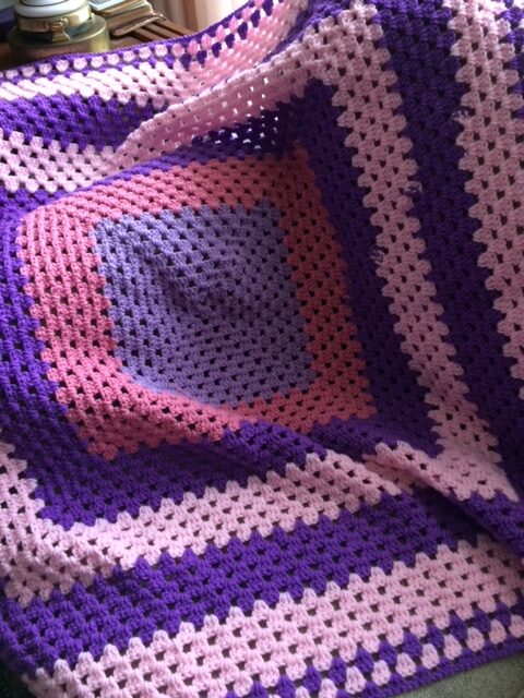 pink and purple crocheted square afghan