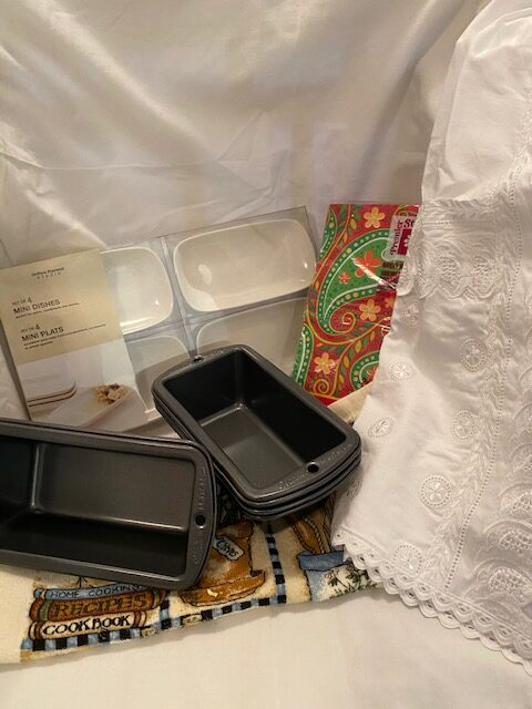 mini-loaf pans, mini condiment serving dishes; lace-trimmed hostess half apron, a tea towel, a package of paper dinner napkins