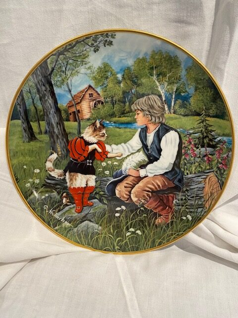 front of a collector plate - showing Puss in Boots with a boy seated on a log, with a mill and stream in background