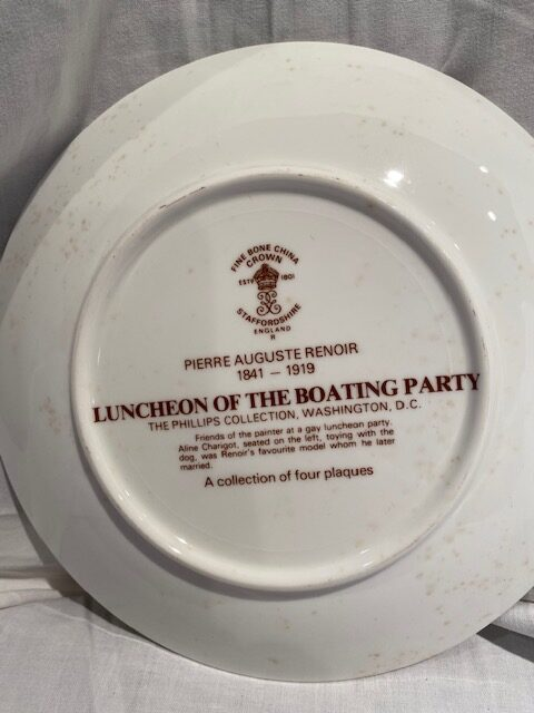 back of a collector plate - titled Luncheon of the Boating Party - Crown bone china Staffordshire