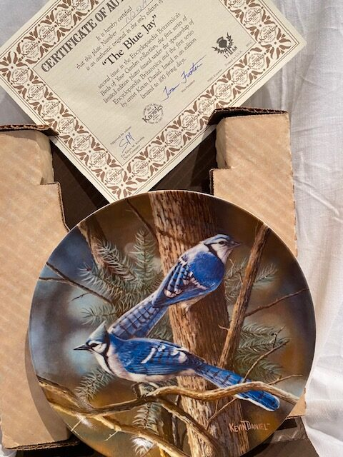 front of a collector plate - showing two blue japs on a pine tree