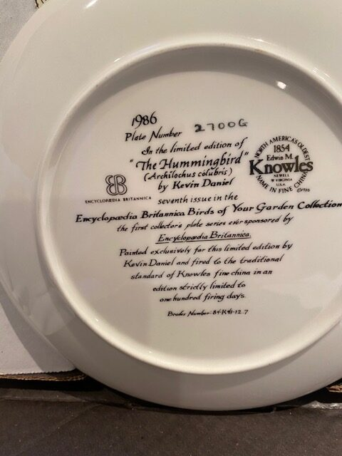 back of a collector plate - titled The Hummingbird - Knowles-Encyclopædia Britannica