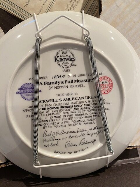 back of a collector plate - titled A Family's Full Measure, by Norman Rockwell - Knowles