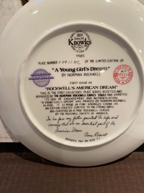 back of a collector plate - titled A Yong Girl's Dream, by Norman Rockwell - Knowles