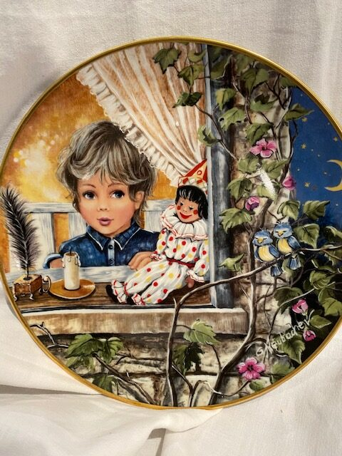 front of a collector plate - showing a boy at an ivy-covered window with a doll