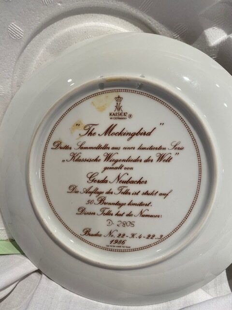back of a collector plate - titled The Mockingbird - Kaiser